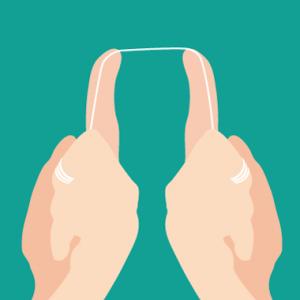 デンタルフロスの上の奥歯への使い方