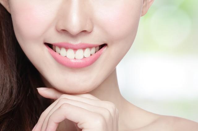 young woman health teeth