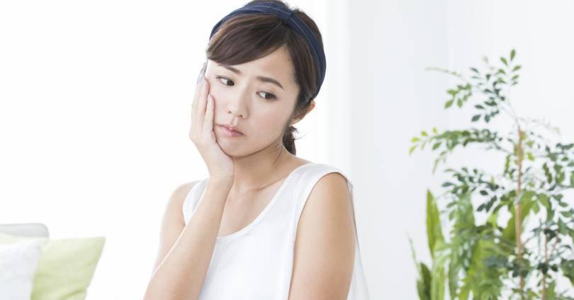 根管治療の痛みが不安な女性